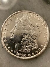 1902 Morgan silver dollar. Cleaned.