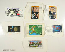 40 MIXED USA STAMPS CANCELED ON PIECES OF ENVELOPES CANCELLED