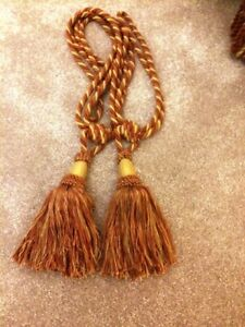 PAIR OF CURTAIN TIE-BACKS IN EXCELLENT CONDITION.
