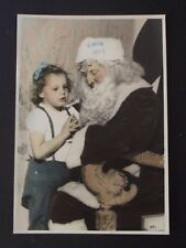 YOUNG GIRL STANDING NEXT TO SANTA SITTING IN A CHAIR Vtg 1947 COLOR PHOTO