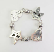 Fun chunky sterling silver hearts and stars designer bracelet by Far Fetched
