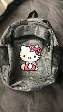 Black and gray hello kitty backpack 3 compartments (zippers) w/ laptop pouch.