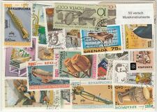 50 verschiedene Briefmarken  mit Musikinstrumenten  Trompete  Klavier  Trommel