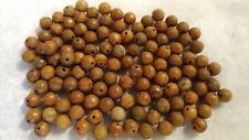 15 Perles en bois pétrifié