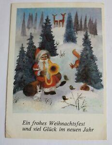 AK Ein frohes Weihhnachtsfest .....Weihnachtsmann musiziert im Wald, E. Nerger