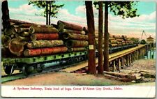 "Coeur D'Alene Idaho Postcard ""A Spokane Industry, Train Load of Logs"" Dock 1910s"