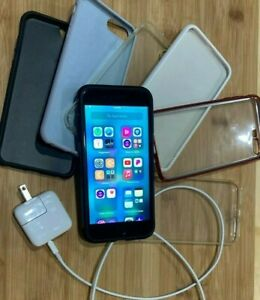 Apple iPhone 8 Plus - 64GB - Space Gray With Apple charger/cable and 7 Cases
