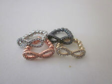 wholesale set of  4 infinity adjustable ring in four different  color .