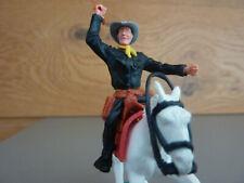 Timpo / Cowboy in schwarz mit Peitsche / Pferd galoppierend in weiß