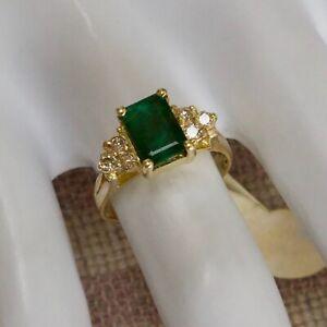 ESTATE FOURTEEN KARAT YELLOW GOLD 1.70 CARAT EMERALD & DIAMOND RING (size five)