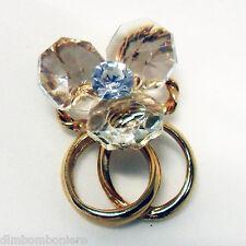 Bomboniera Calamita con fedi oro o argento, fiore in cristallo e punto luce