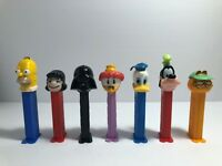 PEZ DISPENSERS Lot Of 7 Vader, Donald Duck, Goofy, Gearloose, Lucy, Homer, Garf