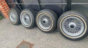 "Jaguar wire wheels 15"" set of 4 with tyres. Suit E type S3."