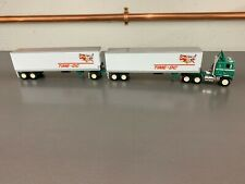 DCP #31342 1:64 Time-DC International Transtar II with Turnpike Doubles