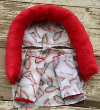 infant headsupport and matching strap covers baseballs with red minky sports