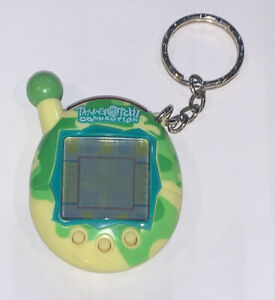 Tamagotchi Connection v4.5 Yellow Green Works Electronic Game Keychain Ring Camo
