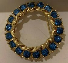 VINTAGE JEWELY BLUE RHINESTONE  IN CIRCLE BROOCHE
