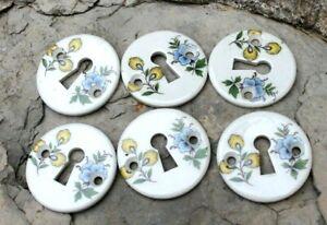 6 entrées de serrure a décors de fleurs en porcelaines