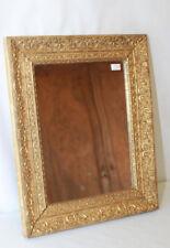 Miroir dans un cadre doré au décor de rinceaux Glace