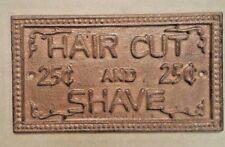 Haircut and Shave Sign Plaque made of cast iron metal with rustic brown finish