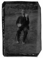 Tintype Photograph Outdoors Seated Man Holding Balls of Wool in Both Hands