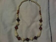 Costume Jewellery Necklace White and Looks like Amber.