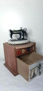 Wooden box with a small sewing machine. Decorations