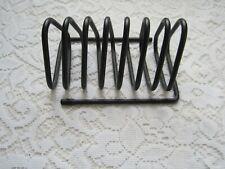 A Black Metal Cd/Dvd/Game Wire Rack