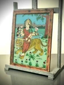 VINTAGE INDIAN REVERSE GLASS PAINTING. HINDU FEMALE DEITY, DURGA SEATED ON TIGER