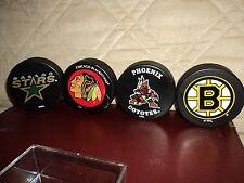 (4) NHL Hockey Pucks With (1) Case-Stars-Blackhawks-Coyotes-Bruins