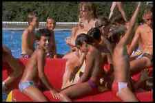 633031 Teenagers In A Swimming Pool A4 Photo Print