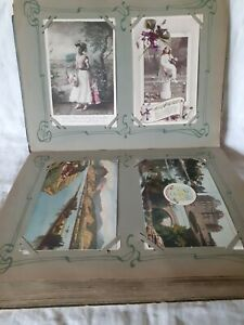 A FULL TATTY OLD ALBUM OF OLD AND VINTAGE MIXED POSTCARDS