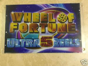 IGT Wheel of Fortune sign, slot machine plexiglass sign. W.O.F.,  Ultra 5 Reels