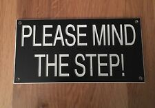 Engraved mind the step sign