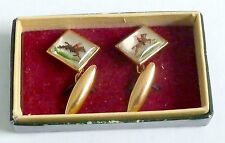 A VINTAGE 1920s PAIR OF GOLD TONE PAINTED PICTURE CUFFLINKS - HORSE & RIDER