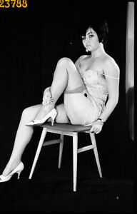 pretty woman in camisole, nylon stockings,  1970s vintage fine art negative