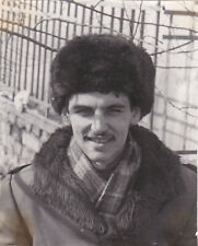 1980s Handsome man in fur hat in winter fashion old Russian Soviet photo gay int