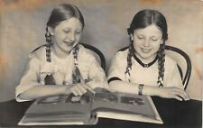 Real Photo Postcard Two Sisters Twins Looking at Photo or Postcard Album~115791