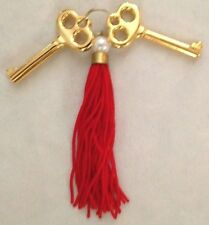 "Goldtone Metal 1 3/4"" Two Decorative Skeleton Keys With Red Dangle"