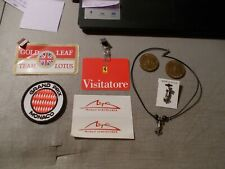 LOT OF 8 FORMULA 1 PIECES 2-MEDALS , 4 PATCHES , A NECKLACE AND A PIN