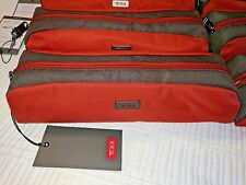 New With Tags   TUMI Cord Pouch  Orange/Grey Long Cord Pouch