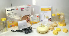 MEDELA SWING ELECTRIC BREAST PUMP WITH EXTRA BOTTLES AND ACCESSORIES