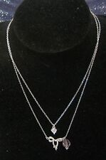 Wonderful silver tone metal chain with various small pendants