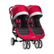 Poussettes et systèmes combinés de promenade rouges avec harnais à cinq points pour bébé dès la naissance