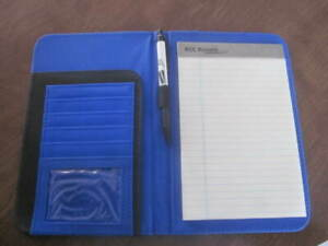 """BLOCKBUSTER Notebook with labelled pen and notepad.  Book labelled """"Get a Clue"""""""