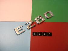 GENUINE MERCEDES BENZ E280 CHROME PLASTIC REAR BADGE EMBLEM. A 124 817 56 15
