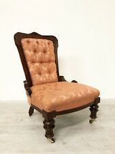 ANTIQUE VICTORIAN PERIOD CARVED ORNATE MAHOGANY NURSING CHAIR ON CASTORS