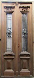 Double antique entry door with iron insert