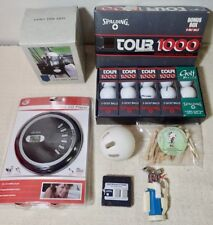a lot of vintage golf accessories and collectibles range finder CD player balls