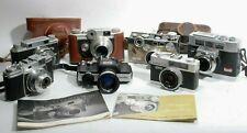 Lot of 7 Vintage Cameras Konica Minolta Argus For Parts/Repair + 2 Manuals Cases